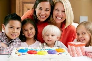 two women and children celebrating birthday